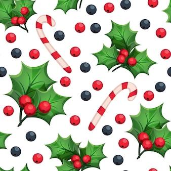 Рождественский фон с декоративными элементами: зеленые листья, красные и синие ягоды, конфета