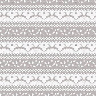 Christmas seamless pattern with deer and holly.