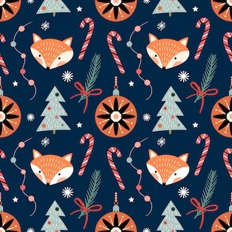 キツネと装飾品とのクリスマスのシームレスなパターン