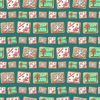 Рождественский фон с подарочной коробкой. пряники на зеленом фоне