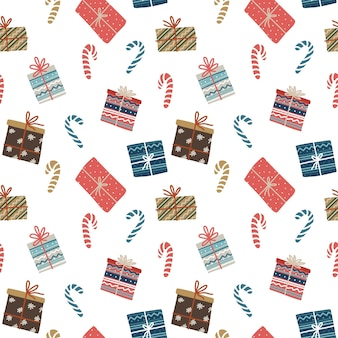 Christmas seamless pattern with gift boxes and candies