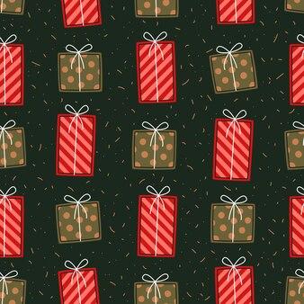Рождественский фон с красными и зелеными подарочными коробками. повторяющийся праздничный узор
