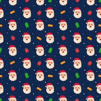 青い背景で隔離のサンタとクリスマスのシームレスなパターン