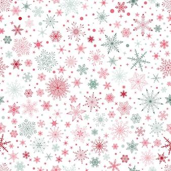 さまざまな複雑な大小の雪片、白地に赤と灰色のクリスマスのシームレスなパターン