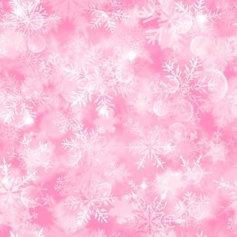 ピンクの背景に白いぼやけた雪、まぶしさと輝きとクリスマスのシームレスなパターン