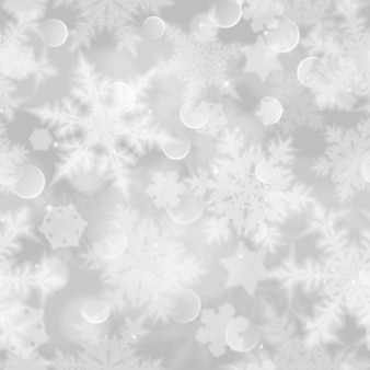 Christmas seamless pattern with white blurred snowflakes, glare and sparkles on gray background