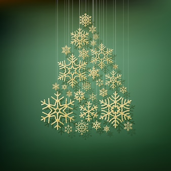 Christmas shining fir tree made from gold snowflakes.