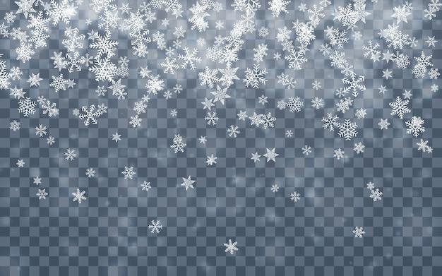 クリスマスの雪。青い背景に降る雪片。降雪。