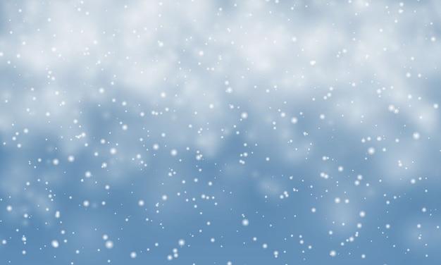 クリスマスの雪。青い背景に落ちる雪片。降雪。