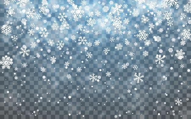 クリスマスの雪。暗い背景に降る雪。降雪。