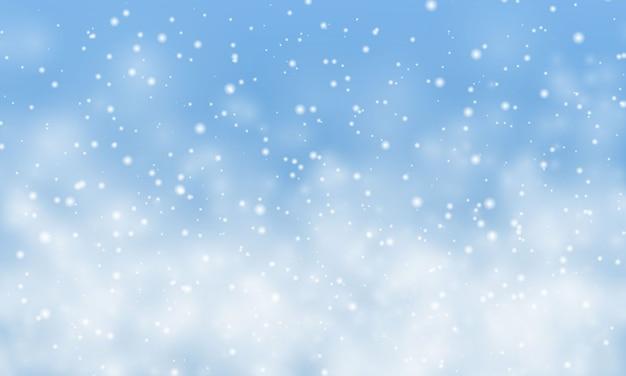 크리스마스 눈. 밝은 파란색 배경에 떨어지는 눈송이. 강설량.
