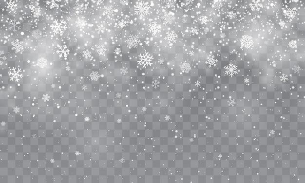 Рождественский снег. падающие снежинки на прозрачном фоне. снегопад.
