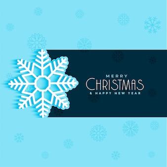 Christmas snow flake design on blue background