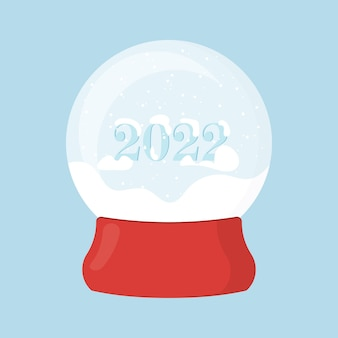 Christmas snow globe on a red stand a ball with the snow new year 2022
