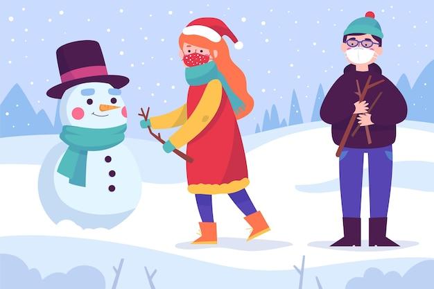 Christmas snow scene wearing masks