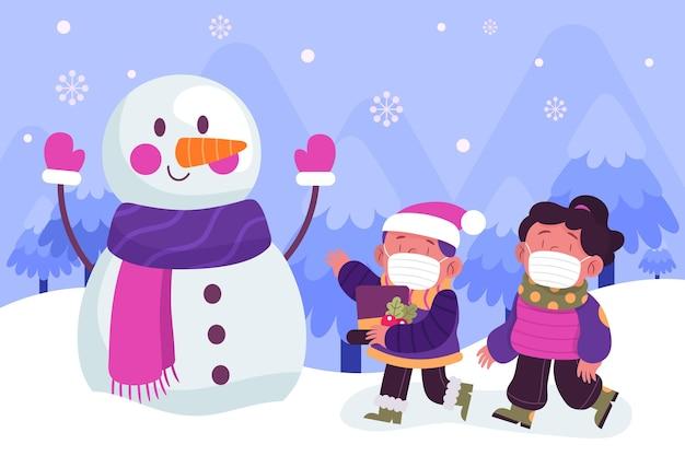 Scena di neve di natale con bambini che indossano maschere