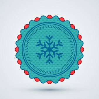 クリスマスの雪の結晶のバッジ