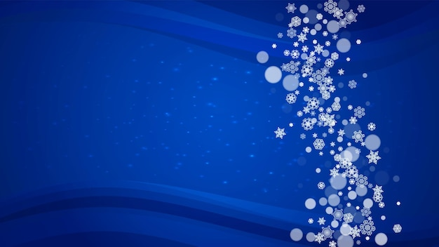 Christmas snowflakes on blue background with sparkles. horizontal frame for winter banner, gift coupon, voucher, ads, party events with christmas snowflakes. falling snow for holiday celebration