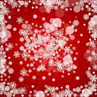 Рождественские снежинки на красном фоне. рамки для сезонных зимних баннеров, подарочные купоны, ваучеры, реклама, праздничные мероприятия. цвета санта-клауса с рождественскими снежинками. падает снег для празднования праздника