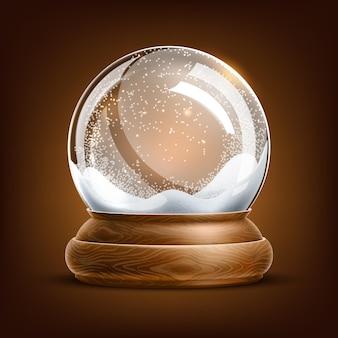 茶色の背景にクリスマスのスノードーム。雪の結晶が中にあるリアルな冬の休日のシンボル