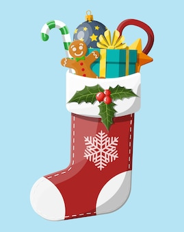 Рождественский носок с холли, подарочная коробка, пряничный человечек, леденец из стеклянного шарика. с новым годом украшение. с рождеством христовым. празднование нового года и рождества.