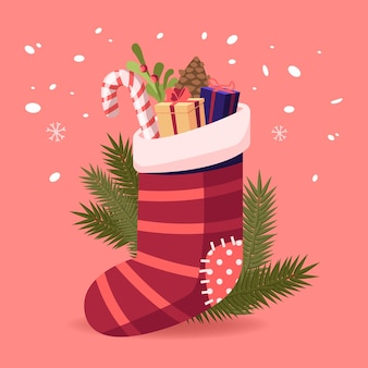 ギフトやお菓子のクリスマスソックス。サンタクロースからの伝統的なプレゼント、暖炉やモミの木のクリスマスの装飾