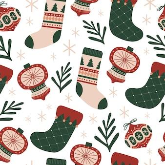 クリスマスの靴下と装飾品は、ファブリックリネンテキスタイルのための甘いデザートのシームレスなパターンを残します