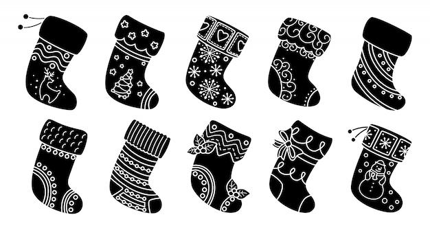 크리스마스 양말 평면 실루엣 세트 검은 글리프 만화 휴가 전통과 화려한 스타킹. 선물, 장식 홀리, 패턴 크리스마스 양말. 새해 디자인 컬렉션. 삽화