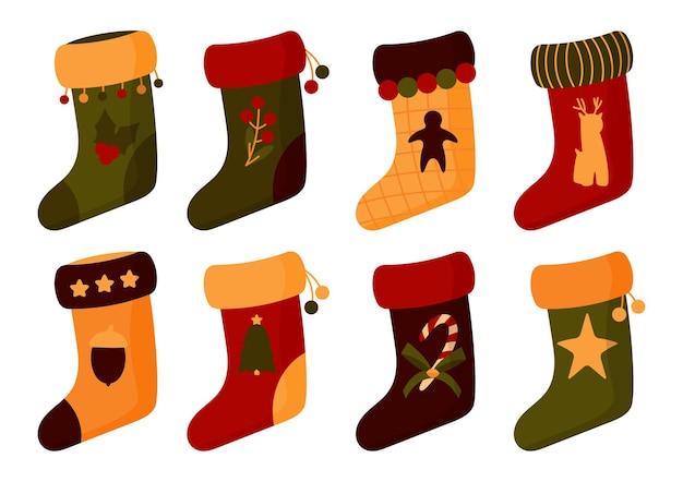 Рождественские носки установлены. сапоги деда мороза с елкой, звездой.