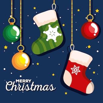 ボールがぶら下がっているクリスマスソックス、新年のバナーとメリークリスマスのお祝いのデザイン