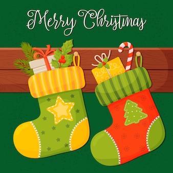 Рождественские носки с подарками, на зеленом фоне. иллюстрация