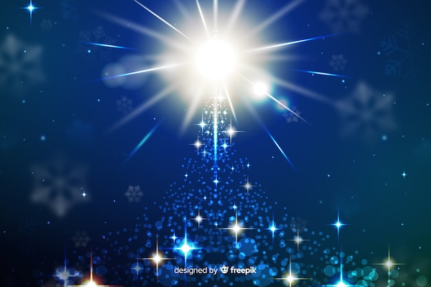 Christmas sparkling background on blue shades