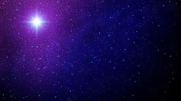Рождественская звезда. ночное небо с сияющими звездами.