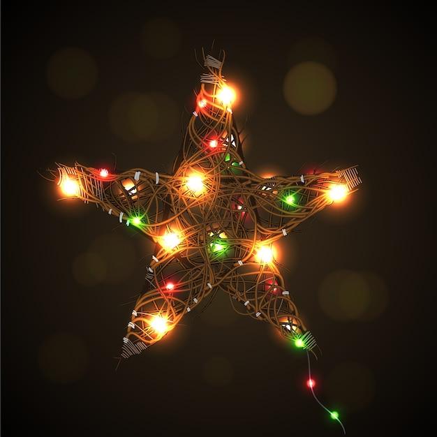 明るい花輪の背景を持つクリスマスの星。