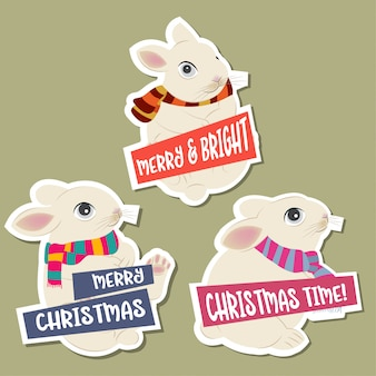 Christmas stickers collection with rabbits and wishes. flat design. vector