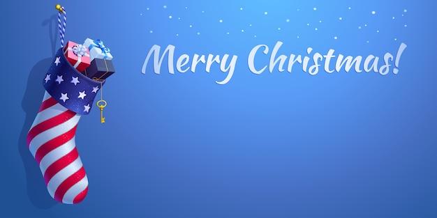 アメリカ国旗のスタイルのクリスマスの靴下。ギフトボックス付きの3dリアルな靴下型バッグ。雪が降る青い背景、書道のテキスト「メリークリスマス」とコピースペース。