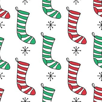 クリスマスの靴下。シームレスなパターン。