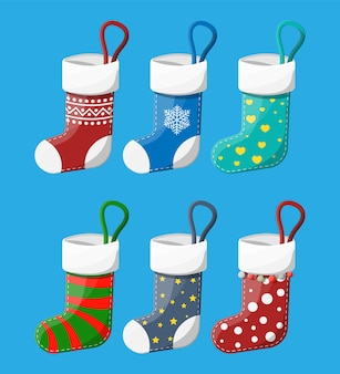 Christmas stockings in various colors. set of christmas cloth socks. hanging holiday decorations for gifts. new year and xmas celebration.