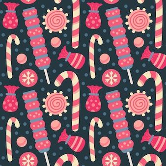キャンディー、キャンディケインとロリポップ、糖衣錠、ゼリー、チョコレートクッキーとクリスマスのお菓子のシームレスなパターン。秋と冬の休日。壁紙、印刷、パッケージ、紙、テキスタイルデザイン。 20の1つ