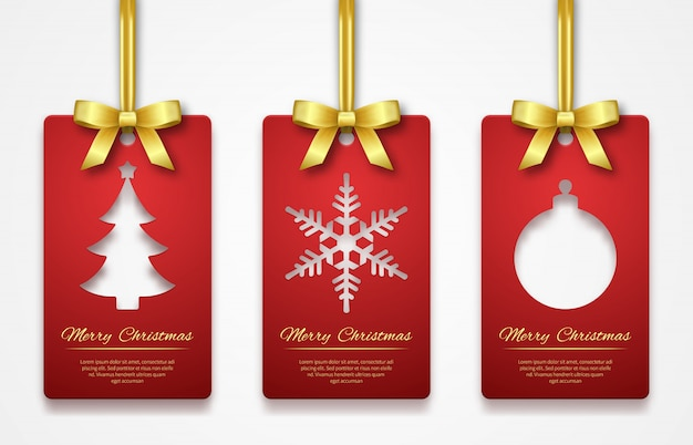 Christmas tags on white background with golden ribbon