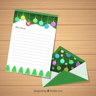 Modello di natale di una lettera con una busta