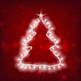Modello di natale con sagoma di albero e ghirlanda luminosa leggera su rosso