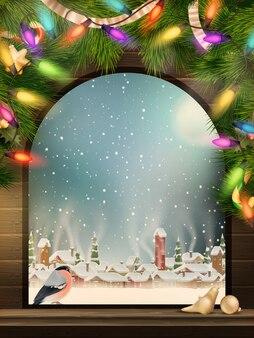 Рождественская тема - окно с видом на зимнюю деревню.