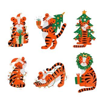 2022년 새해의 크리스마스 호랑이 동물 캐릭터 마스코트. 산타 모자에 호랑이, 선물 상자 크리스마스 트리 세트를 제공합니다. 달력 클립 아트 기호에 대 한 만화 스트라이프 고양이입니다. 새 해 복 많이 받으세요 평면 벡터 일러스트입니다.