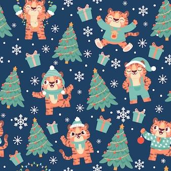 Рождественский тигр бесшовные модели. симпатичные мультяшные тигры в новогодней шапке с елкой, снежинкой и подарочной коробкой. новый год 2022 животных вектор. иллюстрация тигр характер шаблон бесшовные, животное зима