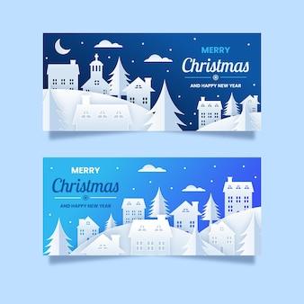 紙のスタイルのクリスマスの町のバナー