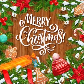Рождественская елка и ветви ягоды падуба обрамляют поздравительную открытку.