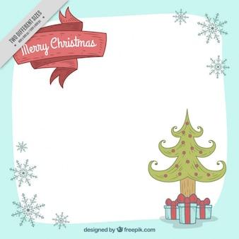 手描きの雪片とクリスマスツリーの背景