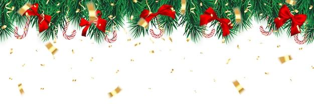 キャンディケインと赤い弓のクリスマスツリーの枝