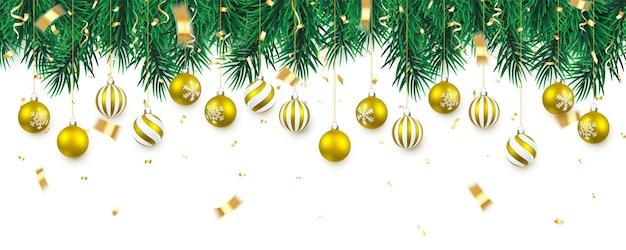 紙吹雪とクリスマスの金のボールとクリスマスツリーの枝